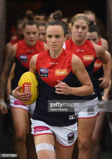 Daisy Pearce of Melbourne leads her team out onto the field during the round seven AFLW match between the Western Bulldogs and the Melbourne Demons...