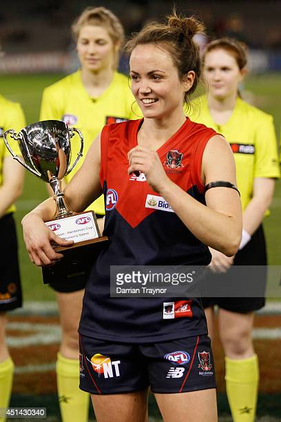 Daisy Pearce of Melbourne with the trophy after the women's exhibition AFL match between the Western Bulldogs and the Melbourne Demons at Etihad...