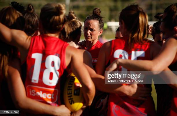 Daisy Pearce of the Demons addresses her teammates during the 2018 AFLW Round 04 match between the Melbourne Demons and the Collingwood Magpies at...