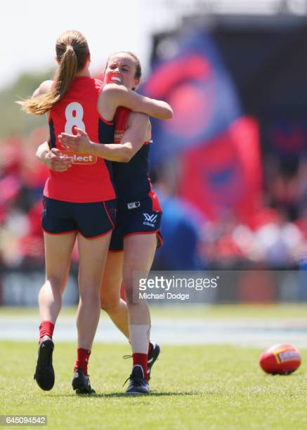 Daisy Pearce of the Demons celebrates the win on the final siren with Sarah Lampard during the round four Women's AFL match between the Melbourne...