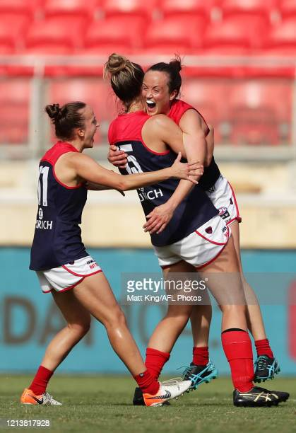 Daisy Pearce of the Demons celebrates victory with team mates after during the AFLW Semi Final match between the Greater Western Sydney Giants and...