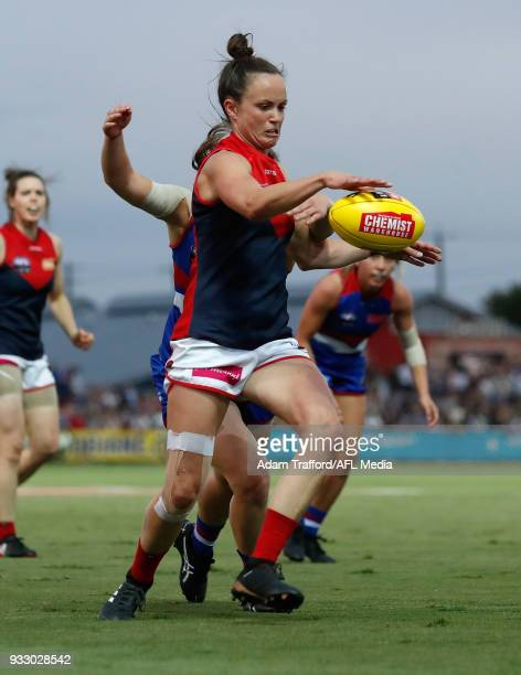 Daisy Pearce of the Demons gets a kick away while being tackled by Kirsty Lamb of the Bulldogs during the 2018 AFLW Round 07 match between the...