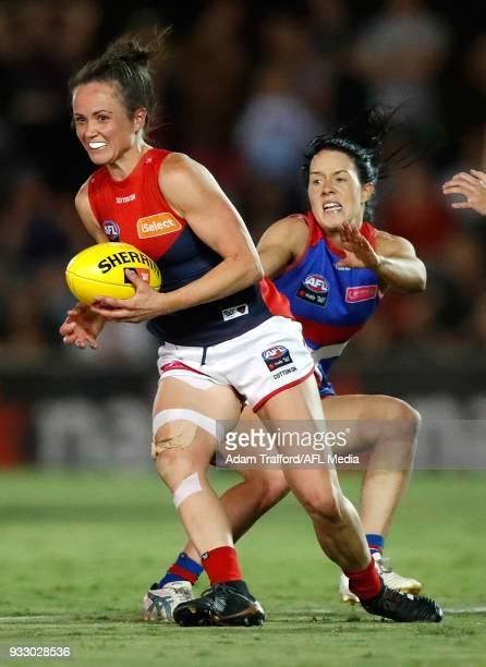 Daisy Pearce of the Demons in action ahead of Brooke Lochland of the Bulldogs during the 2018 AFLW Round 07 match between the Western Bulldogs and...