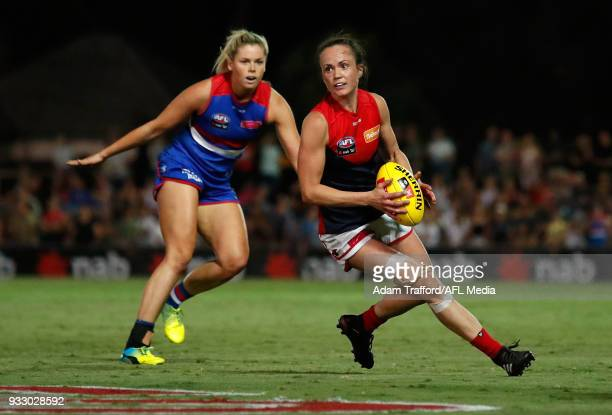 Daisy Pearce of the Demons in action ahead of Katie Brennan of the Bulldogs during the 2018 AFLW Round 07 match between the Western Bulldogs and the...