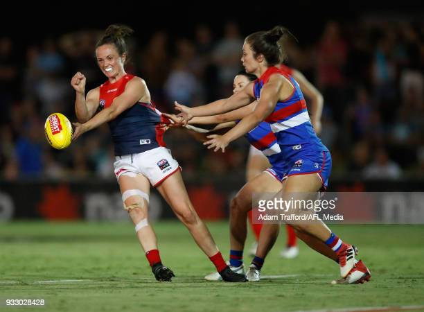 Daisy Pearce of the Demons is tackled by Brooke Lochland and Ellie Blackburn of the Bulldogs during the 2018 AFLW Round 07 match between the Western...