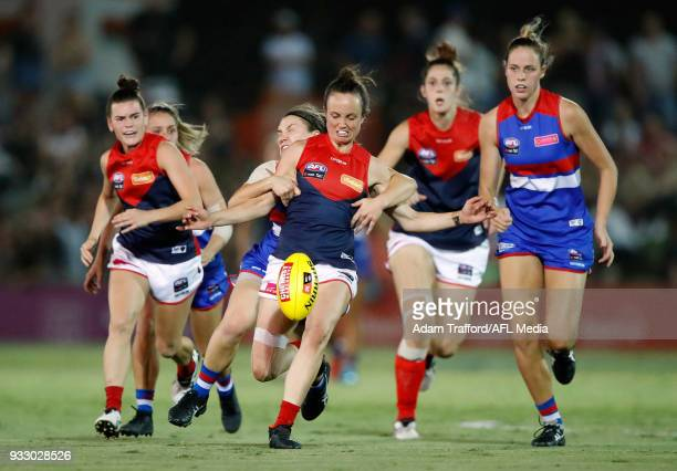 Daisy Pearce of the Demons is tackled by Kirsty Lamb of the Bulldogs during the 2018 AFLW Round 07 match between the Western Bulldogs and the...