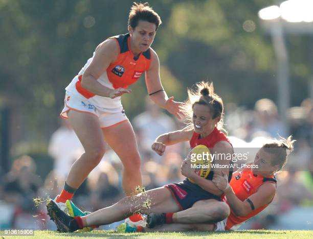 Daisy Pearce of the Demons is tackled during the 2018 AFLW Round 01 match between the Melbourne Demons and the GWS Giants at Casey Fields on February...