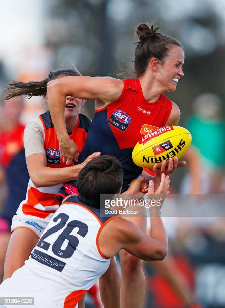 Daisy Pearce of the Demons is tackled during the round one AFLW match between the Melbourne Demons and the Greater Western Sydney Giants at Casey...