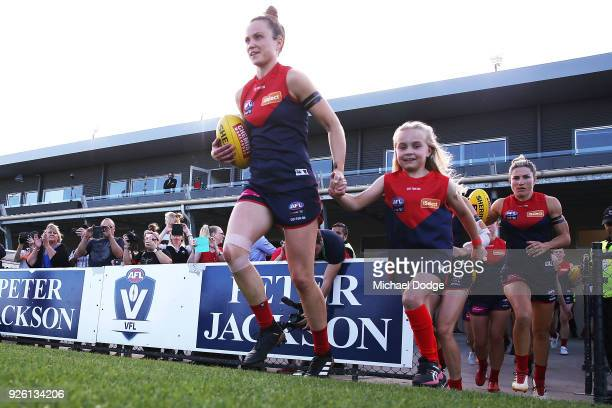 Daisy Pearce of the Demons leads the team out during the round five AFLW match between the Melbourne Demons and the Brisbane Lions at Casey Fields on...