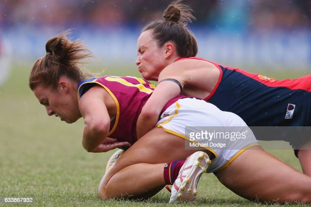 Daisy Pearce of the Demons tackles Jamie Stanton of the Lions during the round one Women's AFL match between the Melbourne Demons and the Brisbane...