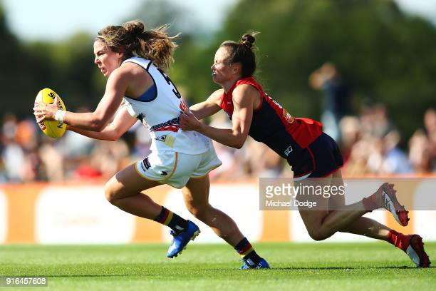Daisy Pearce of the Demons tackles Jenna McCormick of the Crows during the round two AFLW match between the Melbourne Demons and the Adelaide Crows...