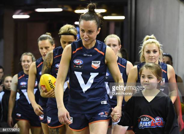 Daisy Pearce of Victoria leads her team out onto the field during the AFL Women's State of Origin match between Victoria and the Allies at Etihad...