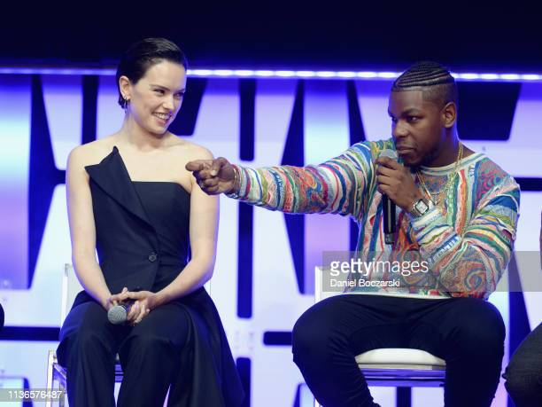 """Daisy Ridley and John Boyega onstage during """"The Rise of Skywalker"""" panel at the Star Wars Celebration at McCormick Place Convention Center on April..."""