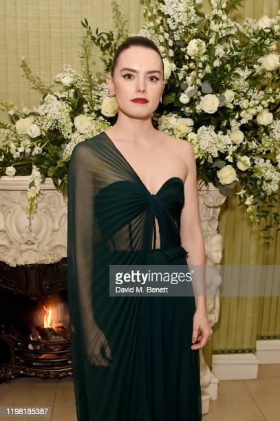 Daisy Ridley and Lisa del Giocondo attend the British Vogue and Tiffany Co Fashion and Film Party at Annabel's on February 2 2020 in London England