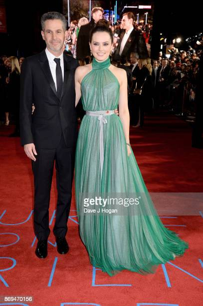 Daisy Ridley and producer Simon Kinberg attend the 'Murder On The Orient Express' World Premiere at Royal Albert Hall on November 2 2017 in London...