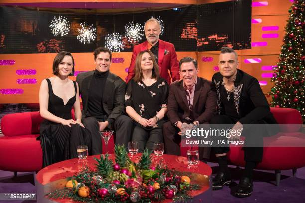 Daisy Ridley Henry Cavill Ruth Jones Rob Brydon and Robbie Williams with host Graham Norton during the filming for the Graham Norton Show at BBC...