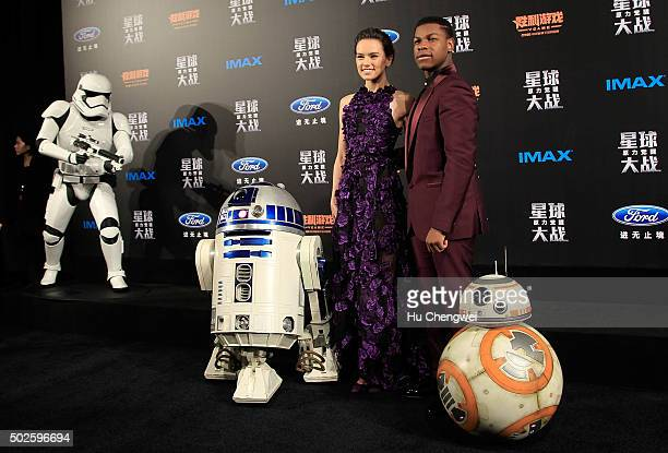 Daisy Ridley left John Boyega right attend the premiere of Star Wars on December 27 2015 in Shanghai China