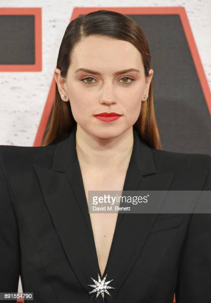 Daisy Ridley poses at the 'Star Wars The Last Jedi' photocall at Corinthia Hotel London on December 13 2017 in London England