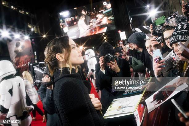 Daisy Ridley signs autographs at the European Premiere of Star Wars The Last Jedi at the Royal Albert Hall on December 12 2017 in London England