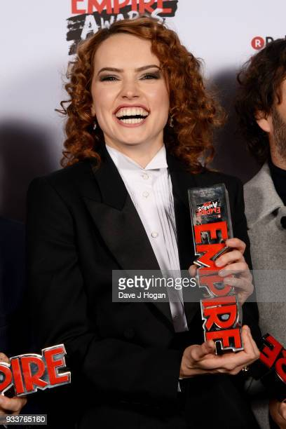Daisy Ridley winner of the Best Film award for 'Star Wars The Last Jedi' poses in the winners room at the Rakuten TV EMPIRE Awards 2018 at The...