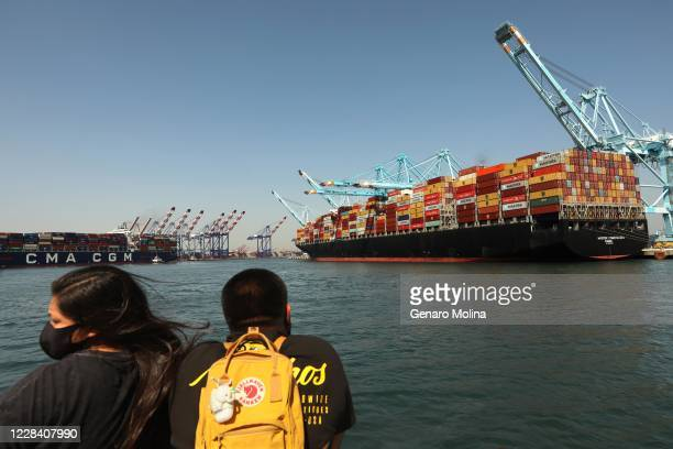 Daisy Saravia left, and Luis Joaquin enjoy a Waterfront Cruise in the Port of Los Angeles, where California air quality officials are poised to adopt...