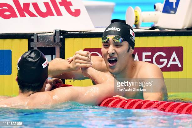Daiya Seto of Japan and Jay Litherland of the United States celebrate after winning the gold and silver respectively after competing in the Men's...