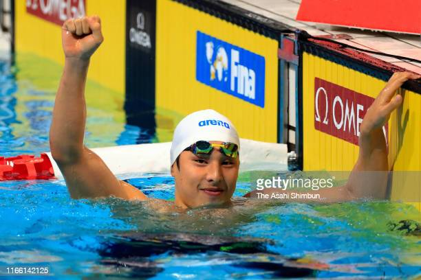 Daiya Seto of Japan celebrates winning the gold meal after competing in the Men's 400m Individual Medley Final on day three of the FINA Swimming...