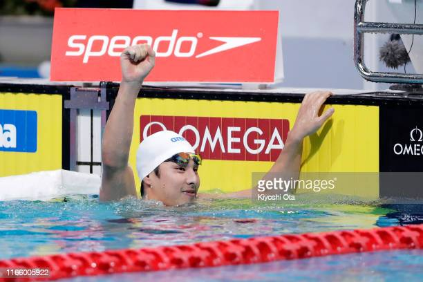 Daiya Seto of Japan celebrates winning the gold medal after competing in the Men's 400m Individual Medley Final on day three of the FINA Swimming...