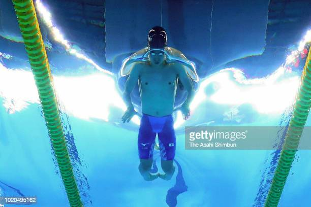 Daiya Seto of Japan competes in the Swimming Men's 200m Individual Medley heat at the GBK Aquatics Center on day two of the Asian Games on August 20,...