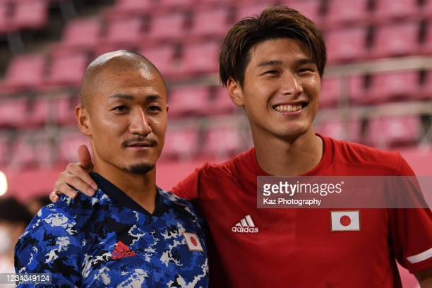 Daizen Maeda and Daiki Hashioka of Japan pose for photographers during the Men's Quarter Final match on day eight of the Tokyo 2020 Olympic Games at...