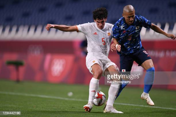 Daizen Maeda of Japan and Jesus Vallejo of Spain compete for the ball at Saitama Stadium on August 3, 2021 in Saitama, Japan.