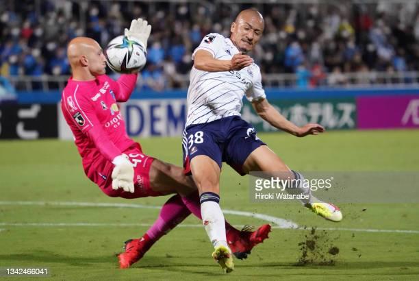 Daizen Maeda of Yokohama F.Marinos and Svend Brodersen of Yokohama FC compete for the ball during the J.League Meiji Yasuda J1 match between Yokohama...
