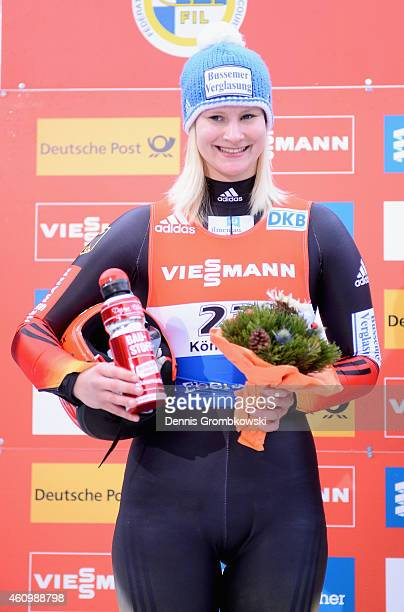 Dajana Eitberger of Germany poses at the podium as she finishes third in the Women's FIL Luge World Cup Koenigssee at Deutsche Post Eisarena on...