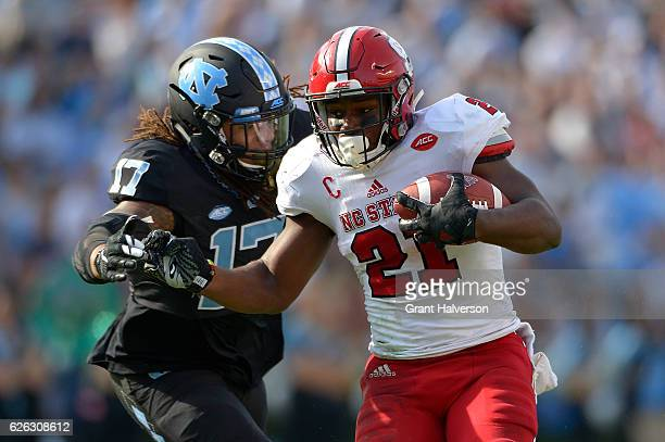 Dajaun Drennon of the North Carolina Tar Heels tackles Matthew Dayes of the North Carolina State Wolfpack during their game at Kenan Stadium on...