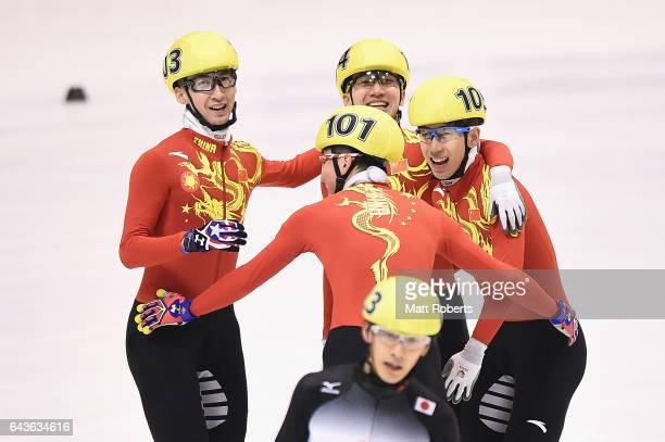 Dajing Wu Hongzhi Xu Ziwei Ren and Tianyu Han celebrate winning in the Short Track Speed Skating men's 5000 metre relay final on day five of the 2017...
