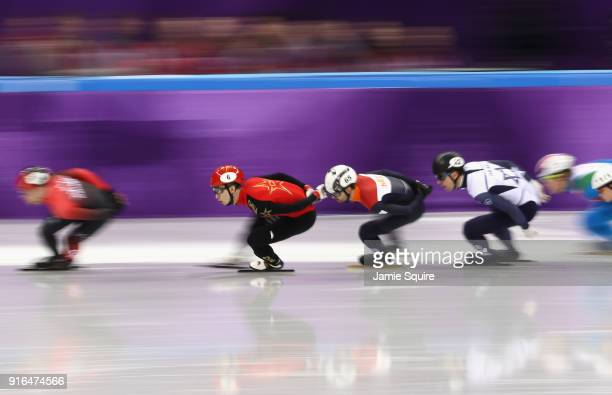 Dajing Wu of China, Itzhak De Laat of the Netherlands and Vladislav Bykanov of Israel compete during the Men's 1500m Short Track Speed Skating...