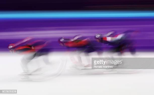 Dajing Wu of China leads from Samuel Girard of Canada and Shaolin Sandor Liu of Hungary in his Men's 500m Short Track Speed Skating Semi Final on day...