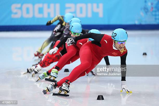 Dajing Wu of China leads the pack in the Short Track Men's 500m Semifinals on day fourteen of the 2014 Sochi Winter Olympics at Iceberg Skating...
