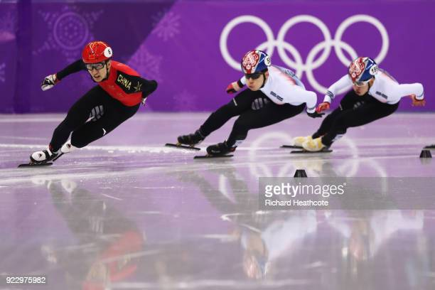 Dajing Wu of China skates on his way to winning gold ahead of Daeheon Hwang of Korea, silver, and Hyojun Lim of Korea, bronze, in the Men's 500m...