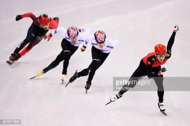 Dajing Wu of China skates on his way to winning gold ahead of Daeheon Hwang of Korea silver and Hyojun Lim of Korea bronze in the Men's 500m Short...