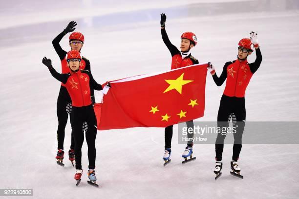 Dajing Wu Tianyu Han Hongzhi Xu and Dequan Chen of China celebrate winning the silver medal during the Short Track Speed Skating Men's 5000m Relay...