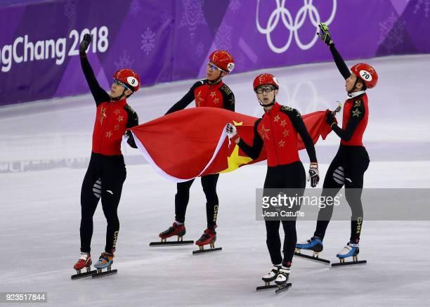 Dajing Wu Tianyu Han Hongzhi Xu and Dequen Chen of China celebrate their second place following the Short Track Speed Skating Men's 5000m Relay Final...