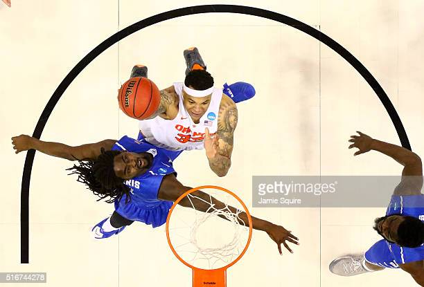DaJuan Coleman of the Syracuse Orange drives to the basket against Darnell Harris of the Middle Tennessee Blue Raiders in the second half during the...