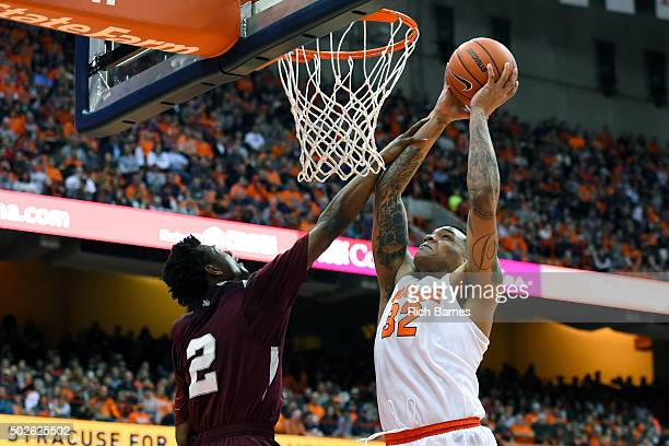 DaJuan Coleman of the Syracuse Orange is fouled by Chris Thomas of the Texas Southern Tigers while shooting the ball during the second half at the...