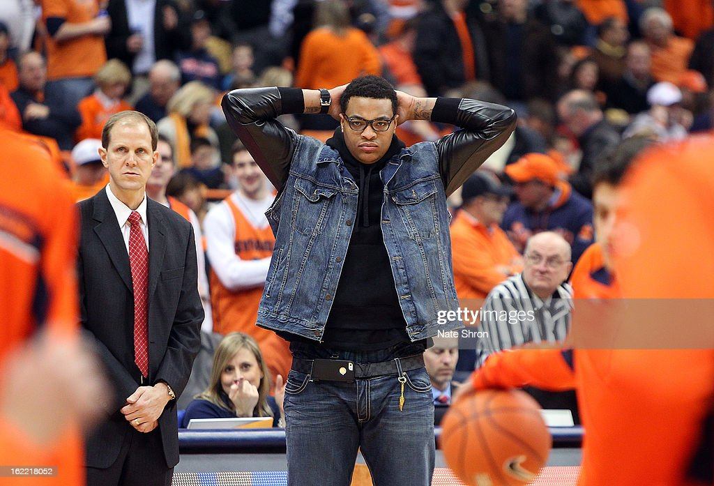 DaJuan Coleman (C) of the Syracuse Orange looks on during warm ups next to assistant coach Mike Hopkins (L) prior to the game against the Providence Friars at the Carrier Dome on February 20, 2013 in Syracuse, New York.