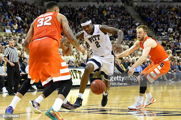 DaJuan Coleman of the Syracuse Orange Michael Young of the Pittsburgh Panthers and Trevor Cooney of the Syracuse Orange react to a loose ball during...