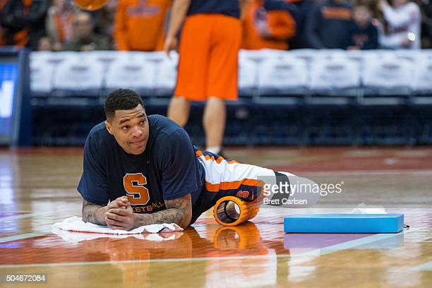 DaJuan Coleman of the Syracuse Orange stretches with a foam roller before the game against the Clemson Tigers on January 5 2016 at The Carrier Dome...