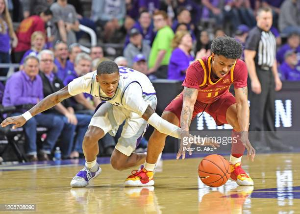DaJuan Gordon of the Kansas State Wildcats reaches in for a loose ball against Prentiss Nixon of the Iowa State Cyclones during the second half at...