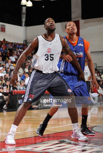 DaJuan Summers of the Detroit Pistons boxes out Alex Acker of the New York Knicks during NBA Summer League presented by EA Sports on July 15 2009 at...