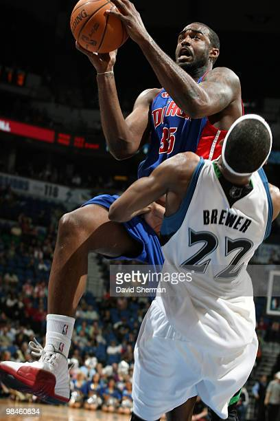 DaJuan Summers of the Detroit Pistons is fouled by Corey Brewer of the Minnesota Timberwolves while going to the basket during the game on April 14...